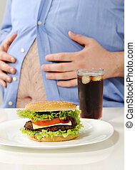 Fat stomach with burger and cola