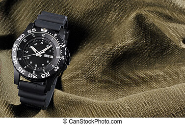 military watch on sack background