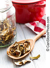 dried mushrooms in wooden spoon - the dried mushrooms in...