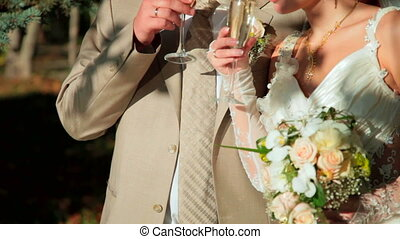 couple with glasses of champagne - Married couple with...