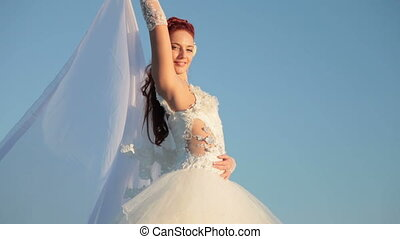 Bride against the blue sky
