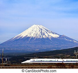 Fuji and Train - A bullet train passes below Mt. Fuji in...