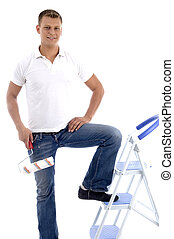 handsome painter standing on ladder chair isolated on white...