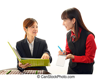 Smiling waitress with customer - Waitress shows the menu to...