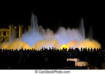 Silhouette People of Magic fountain on Placa De Espanya in...