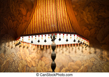 Classic lamp with dim light near wall. - Classic vintage...