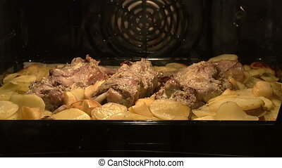 Meat dish in the oven - Time-laps Meat and potatoes baked in...