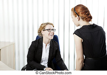 Business colleagues having a chat - Two female business...