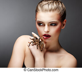 Beautiful Girl Holding Live Tamed Spider in her Hand. Pet