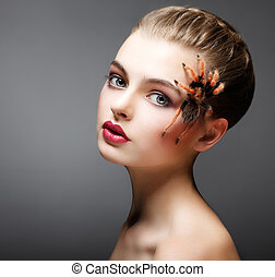 Fantasy. Spider sitting on Pretty Woman Face. Creativity