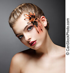 Fantasy. Portrait of beautiful Female Tamer with Spider