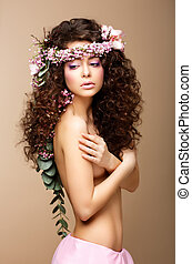 Sultry Beauty Attractive Naked Woman with Long Curly Hair...