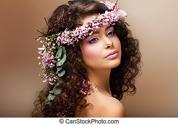 Nymph. Adorable Sensual Brunette with Garland of Flowers...