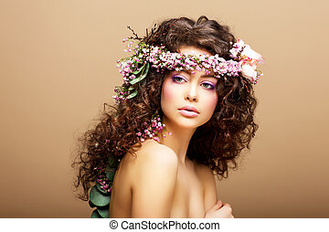 8 March. Springtime. Beauty Woman with Wreath of Flowers over beige