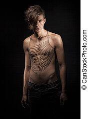 Ultramodern Stylish Young Man standing in Shadows. Romance