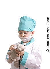 Treating teddy - Boy in doctor suit give medicine to teddy...