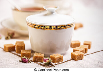 Porcelain sugar bowl with brown lump sugar