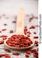 Goji berries - Wooden tablespoon of dried goji berries