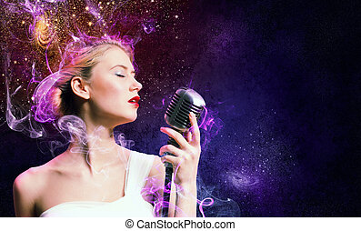 Image of female singer holding microphone against...