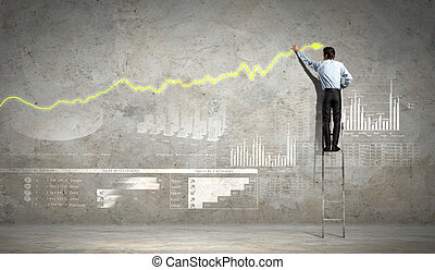 businessman drawing diagram - businessman standing on ladder...