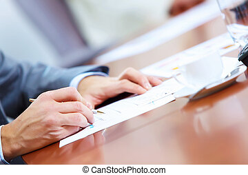 Hands of businessman writing - Image of businessman's hands...
