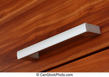 handle - close up of silver furniture handle on wooden...