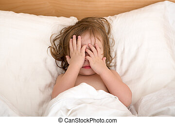 Bad Dreams - Toddler Girl closing her eyes in the bed,...