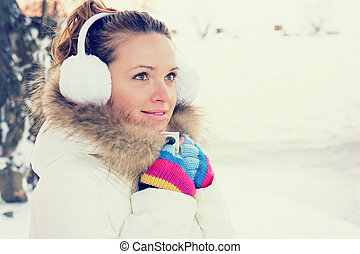 cold winter - a young girl is cold into the winter