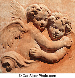 hugging two angels - decoration in tuscan terracotta