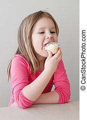 Girl eating ice cream over greay background