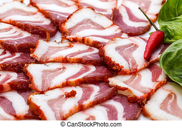 bacon, onion and pepper on a plate in a restaurant