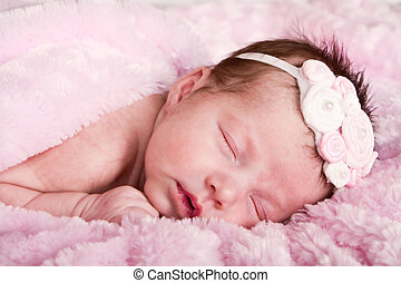 newborn infant sleeping - Newborn infant girl sleeping on a...