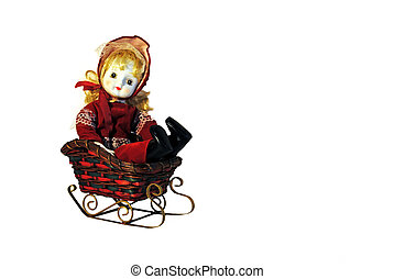 Porcelain doll sledding