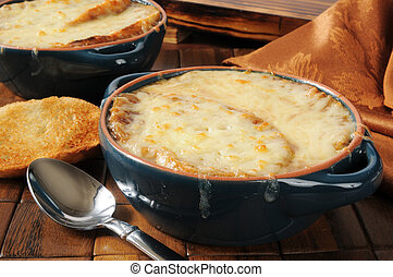 French onion soup - A bowl of French onion soup topped with...