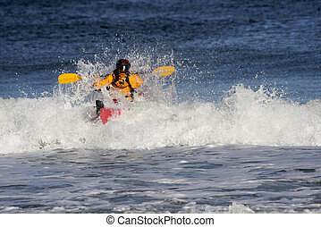 Kayaker over the big wave - Kayaker on the crest of a wave...
