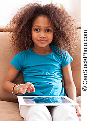 Little african asian girl using a tablet pc - Little african...