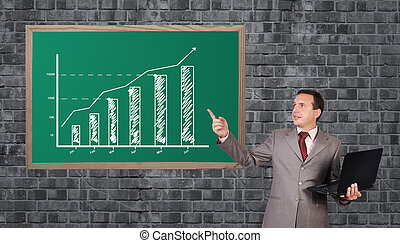 man pointing to chart