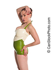 Redhead - Pretty young redhead in green and white latex