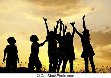 Children holding hands up, space  ready for your message