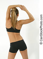 Fitness portrait of a young blond female exercising.