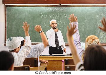 Muslim arabic children with teacher at school