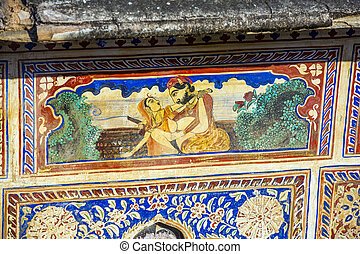 wallpainting of a couple making love on a house facade in...