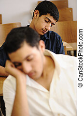 Teen student sleeping at lecture time, college - Teen...