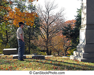 cemetery - man in old historic cemetery with colorful autumn...