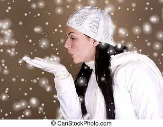 winter woman - pretty brunette wearing a white jacket and...