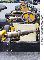 Yellow Go-kart in row