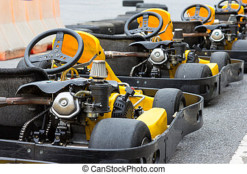 Yellow Go-kart in perspective row