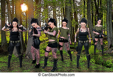 Women with Assault Rifle - Beautiful young women holding an...