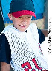 LIttle league baseball player in dugout - Little league...