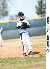 Little league pitcher waiting to pitch - Little league...